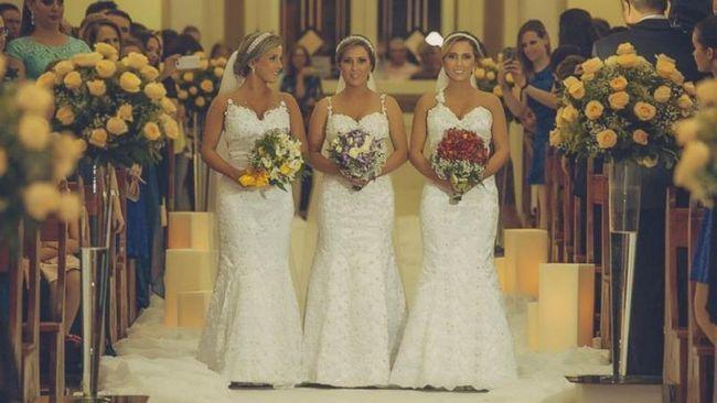 Irmãs trigêmeos idênticos amarrar o nó na cerimônia de casamento conjunta no Brasil