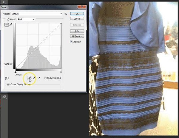 É vestido branco e dourado ou azul e preto?